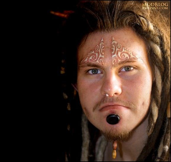 f62f3e7bc Most of us would never consider a tattoo on our face, but this bold wearer  isn't scared. He's got the entire warrior's get-up: The piercings, gauging  of the ...